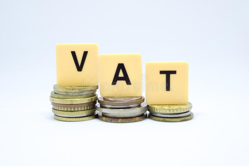 Financie o conceito com a pilha de moedas - impostos sobre o valor acrescentado do ICM escritos sobre fotografia de stock royalty free