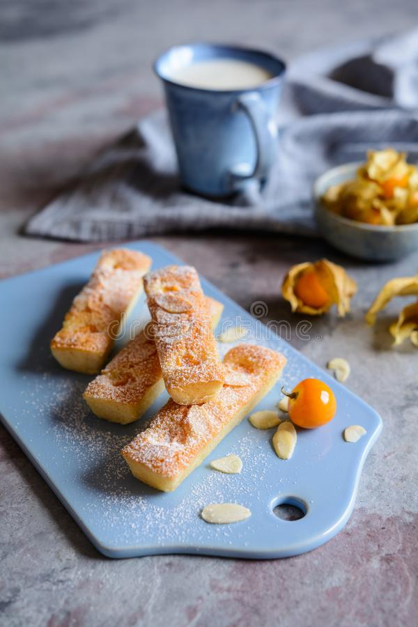 Financier biscuits with Physalis and almond flakes. Traditional Financier biscuits with Physalis and almond flakes stock photography
