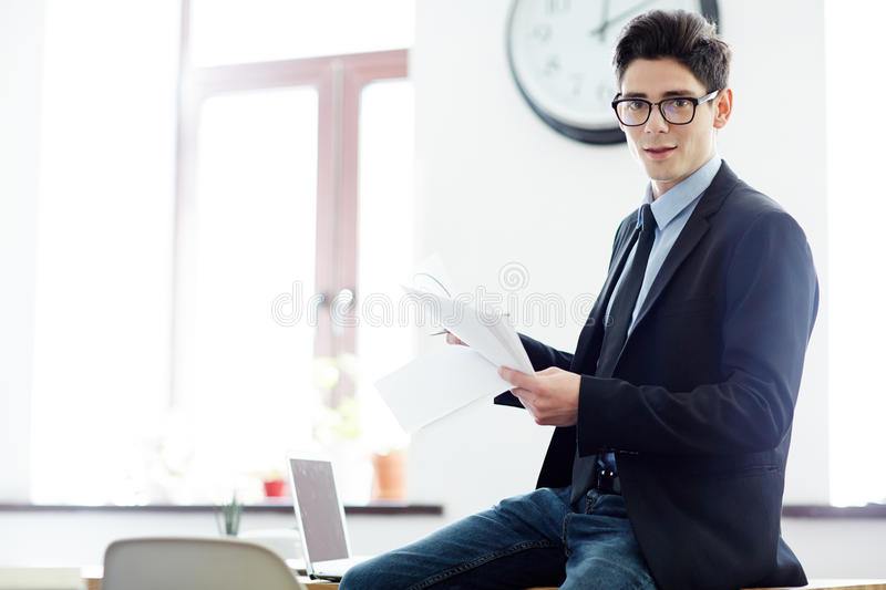 Financier with papers. Young economist with papers working in office royalty free stock photos