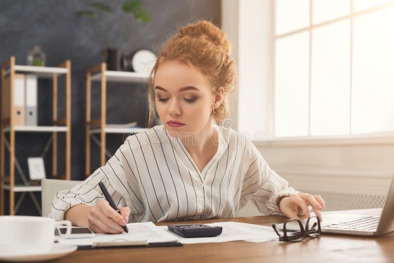 Financier woman working at office desktop royalty free stock image