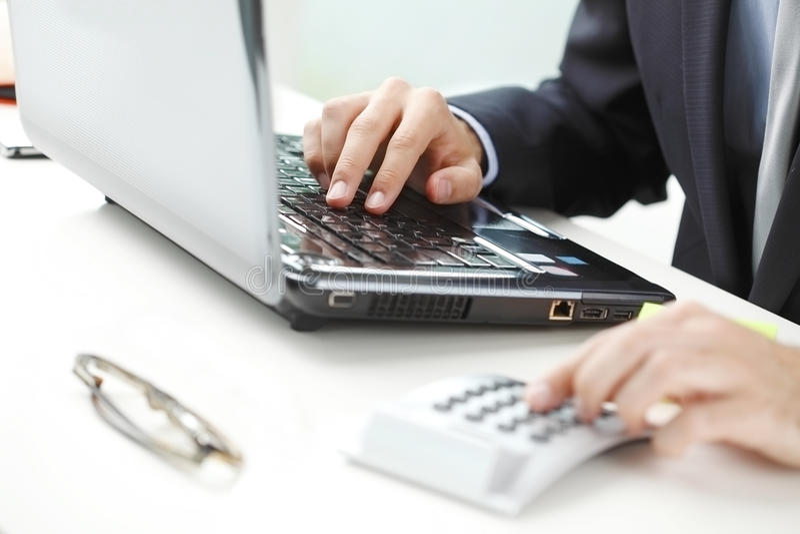 Financier working at bank. Financial adviser calculating datas while working at bank royalty free stock image