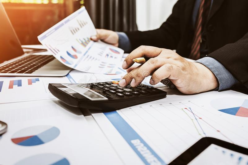 Financiers are calculating personal tax. For customers who use the service royalty free stock photography