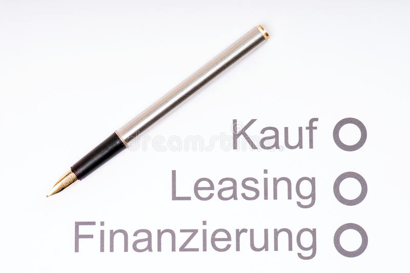 Financing a Car. Pen on a sheet of paper with the German words, buying, leasing and financing royalty free stock photo