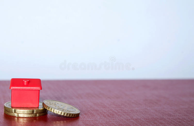 Financing home. Euro cents with plastic house on it royalty free stock photo