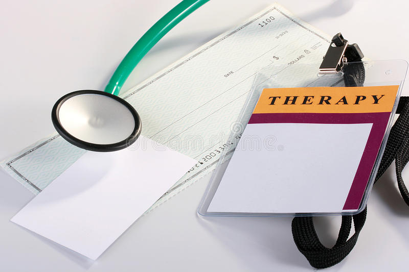 Financing in medicine. ID Card, a stethoscope, a banker's check and a place for card business stock images