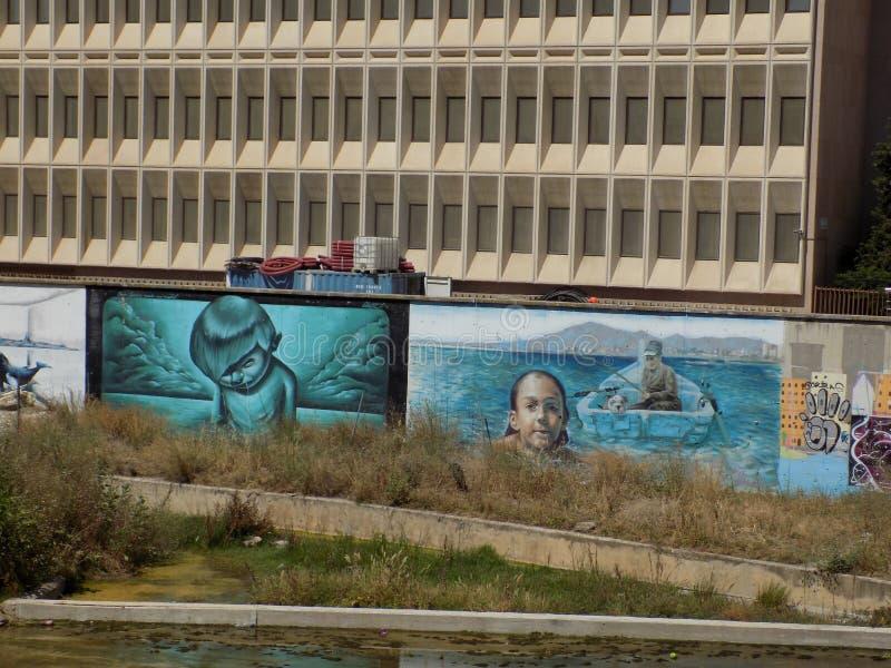 Finansdelegation - grafitti-MALAGA arkivfoton