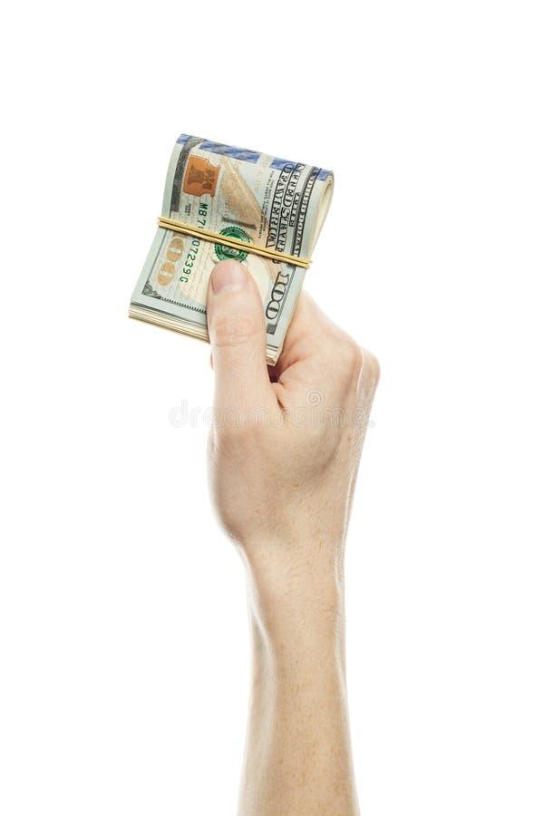 Finansowy pojęcie z ludzką ręką trzyma dolarową walutę USA dolarów 100 rachunek obrazy royalty free