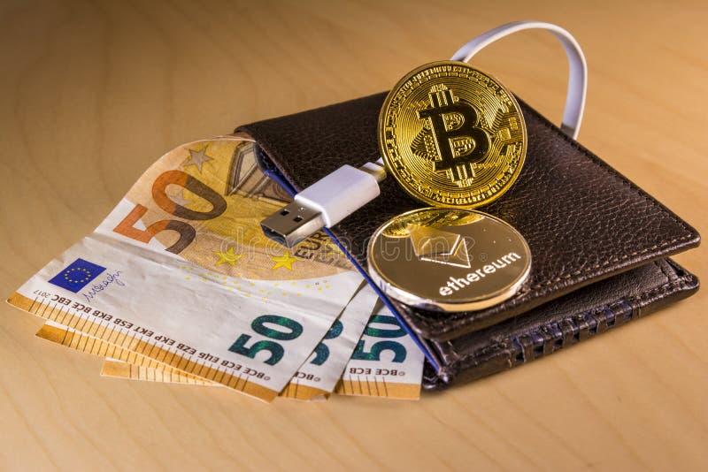 Finanzkonzept mit körperlichem bitcoin und ethereum über einer Geldbörse mit Eurorechnungen stockfotos