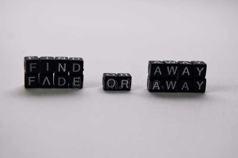 Find away or fade away on wooden blocks. Motivation and inspiration concept stock photos