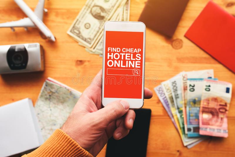Find cheap hotels online mobile phone app stock photos