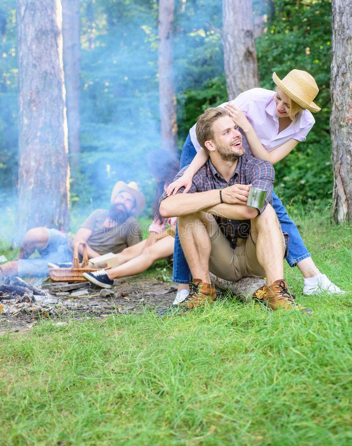 Find companion to travel and hike. Company friends couples or families enjoy relaxing together forest. Friends relaxing. Near campfire after day hiking nature royalty free stock images