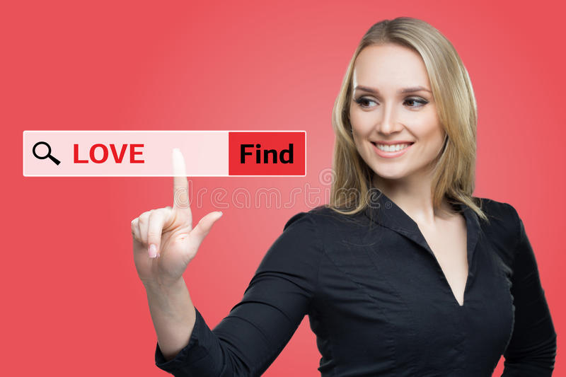Find Love word on red virtual screen touching by business woman stock images
