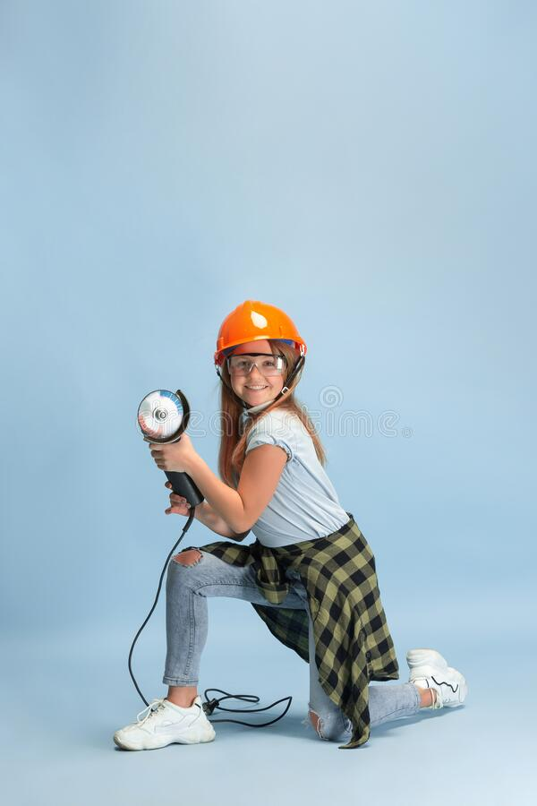 Girl dreaming about future profession of engineer. Find my way. Girl dreaming about profession of engineer. Childhood, planning, education, dream concept. Wants stock photos