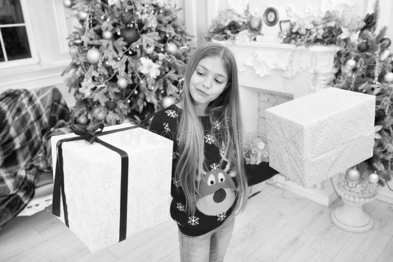 Find presents online. Child enjoy the holiday. Happy new year. Winter. xmas online shopping. Family holiday. Christmas. Tree and presents. The morning before stock photo