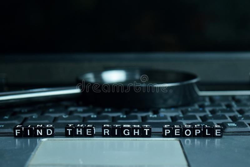 Find the Right People text wooden blocks in laptop background. Business and technology concept royalty free stock images
