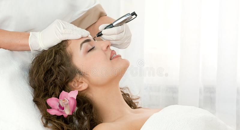Find Similar Get a Comp Save to LightboxSpa salon: young beaut. Health spa: close-up of beautiful relaxing young woman having facial massage electrolysis, with stock images