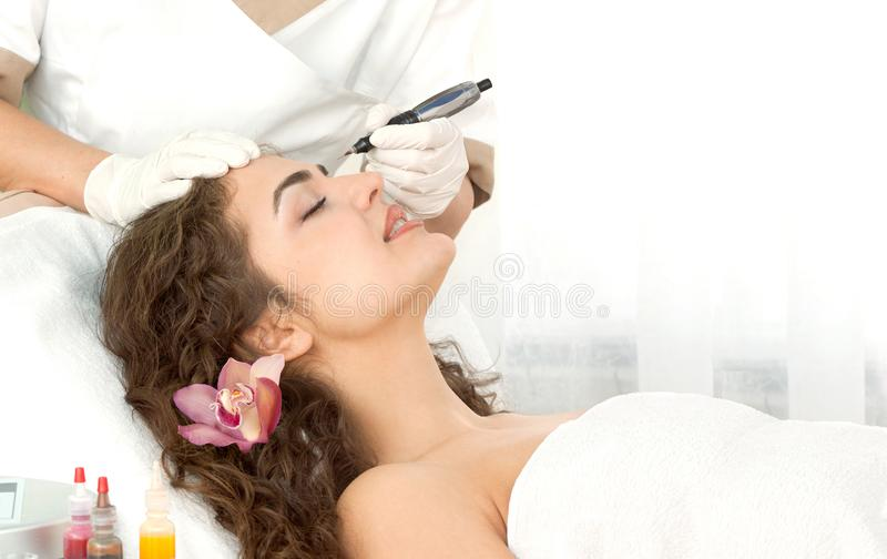 Find Similar Get a Comp Save to LightboxSpa salon: young beaut. Health spa: close-up of beautiful relaxing young woman having facial massage electrolysis, with royalty free stock photography