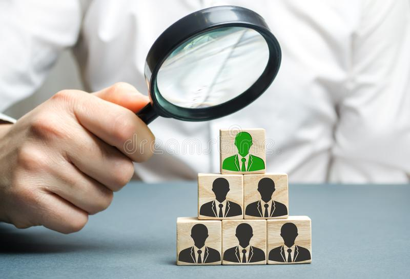 Find a talented employee. Businessman searching for new employees. Staff recruitment. Select a person in the team. Attracting stock image