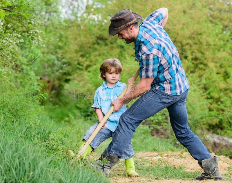 Find treasures. Little boy and father with shovel looking for treasures. Happy childhood. Adventure hunting for stock image