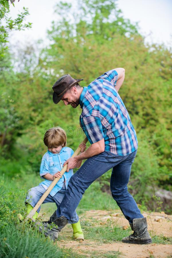 Find treasures. Little boy and father with shovel looking for treasures. Happy childhood. Adventure hunting for stock images