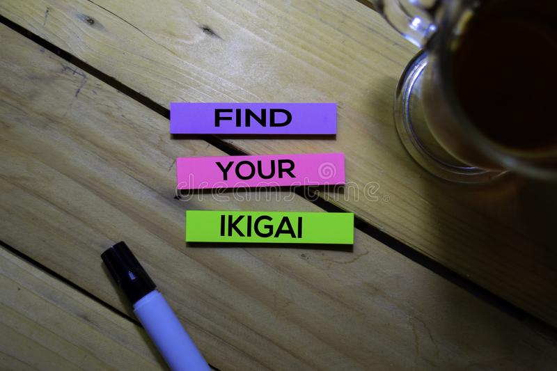 Find Your Ikigai text on sticky notes isolated on Table background. Japanese concept royalty free stock image