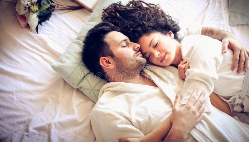 Finding comfort in his arms. royalty free stock photo