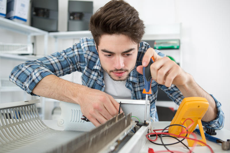 Finding defective part appliance. Finding the defective part of an appliance stock photos