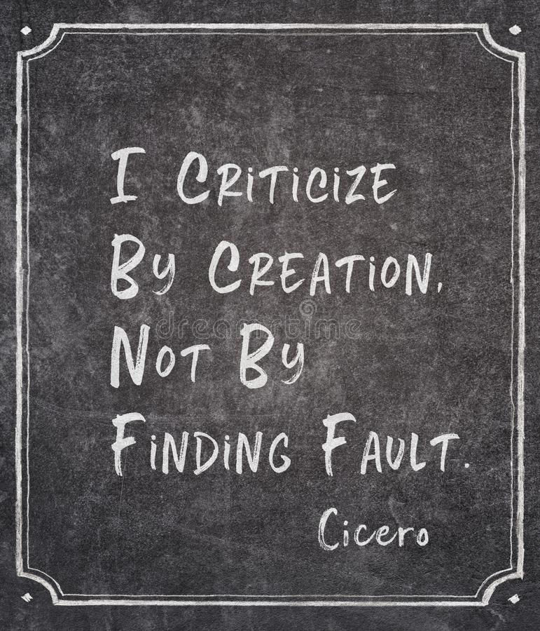 Finding fault Cicero quote. I criticize by creation, not by finding fault - ancient Roman philosopher Cicero quote written on framed chalkboard stock image