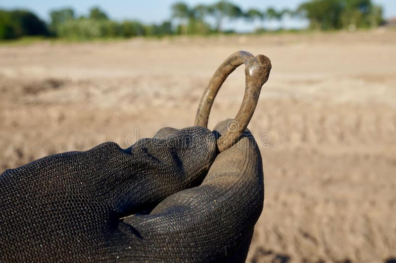 Finding of a metal ring while metal detecting royalty free stock images