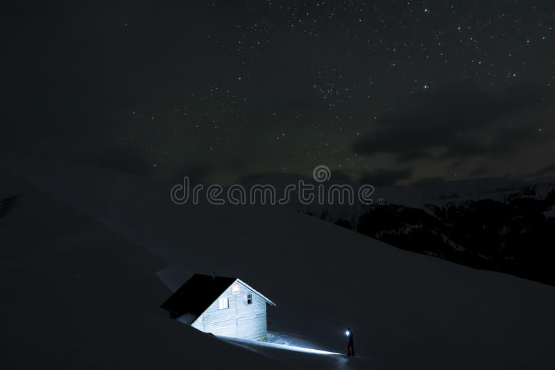 After a long winter day in the mountains we found the refuge when it was already night outside and the stars were shining on the s royalty free stock images