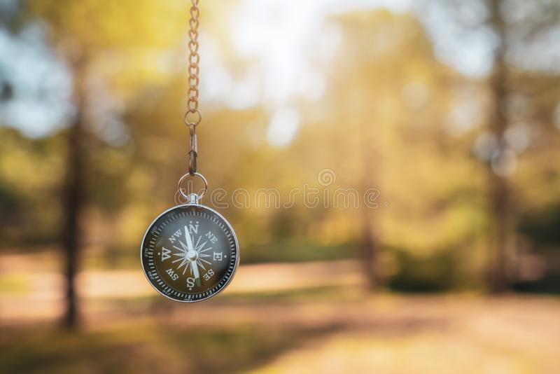 Finding our way in nature with a compass, looking for the right direction stock images