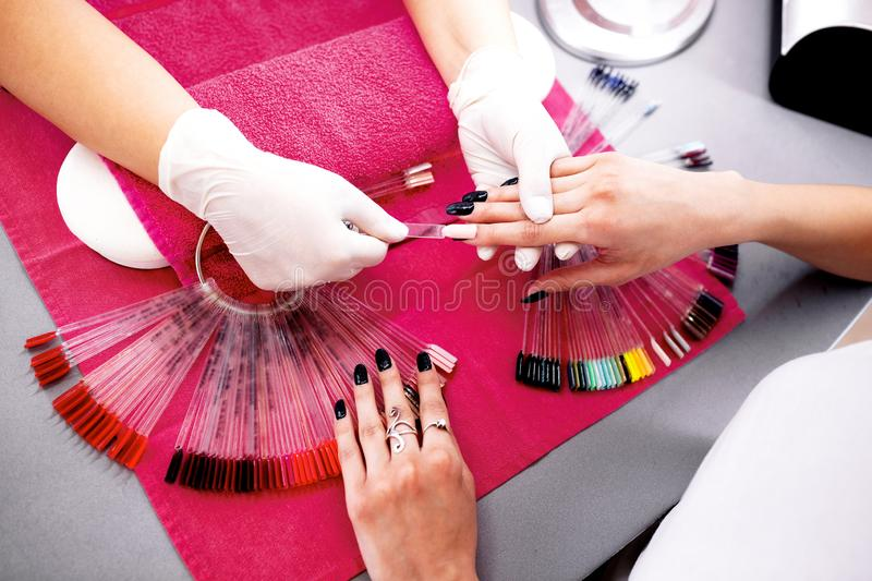 Finding the perfect match with nail color palette stock photos