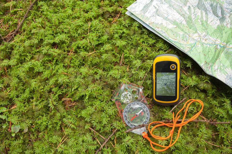 Finding the right position in the forest with a compass, map an stock image