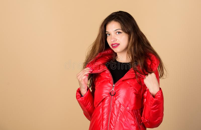 Finding right winter jacket is essential to enjoyable winter season. Snow or rain I am ready for both. Girl enjoy. Wearing bright jacket with hood. Warm coat royalty free stock image