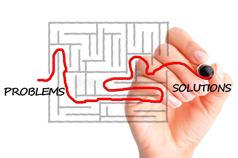 Finding solutions for problems concept suggested by a woman's hand solving a maze royalty free stock photography