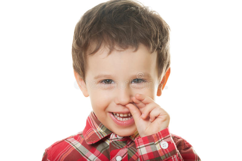 Finding treasure. Cute boy picking nose on isolated white royalty free stock photos