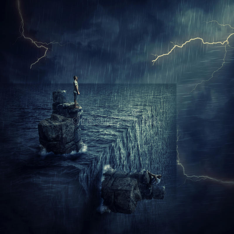 Finding Yourself. Conceptual image with a lost man sitting on a rock cliff island, in the middle of the ocean, trying to find himself in a parallel world royalty free stock photography