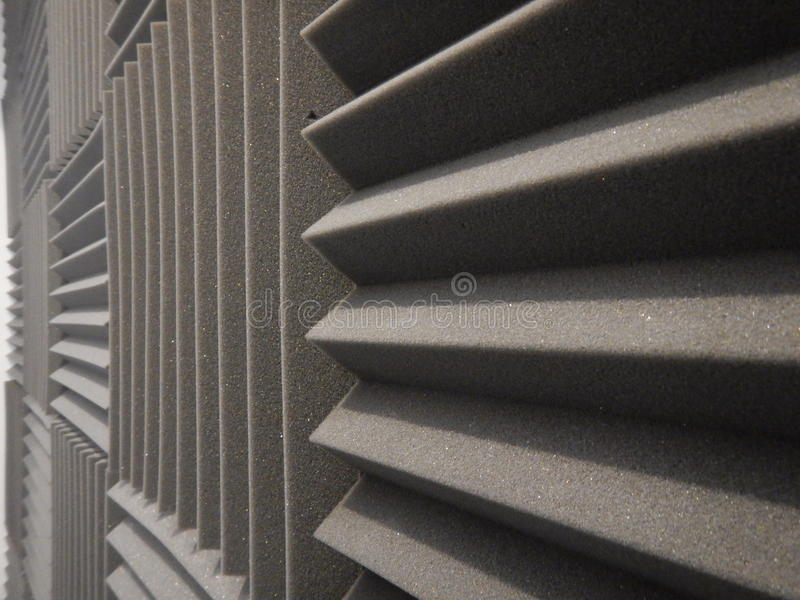 Acoustical foam or tiles for sound dampening. Music room. Soundproof room. Low key photo. Fine Acoustical foam or tiles for sound dampening. Music room stock photo
