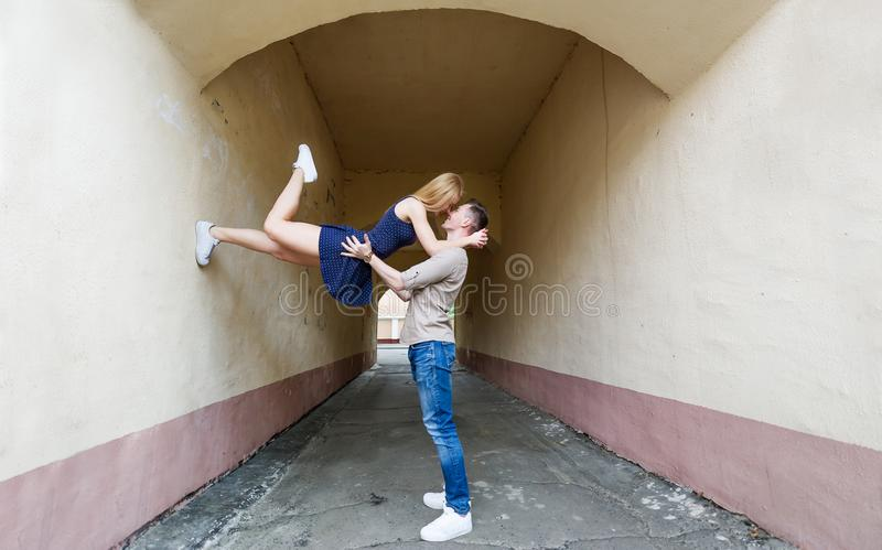 Fine acrobatic kiss. The beautiful sports girl kisses the young man stock images