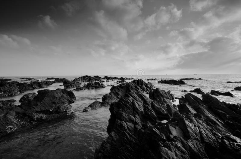 Amazing rock formations at Pandak beach, Terengganu in black and white monochrome fine art technique.  Nature composition. royalty free stock images