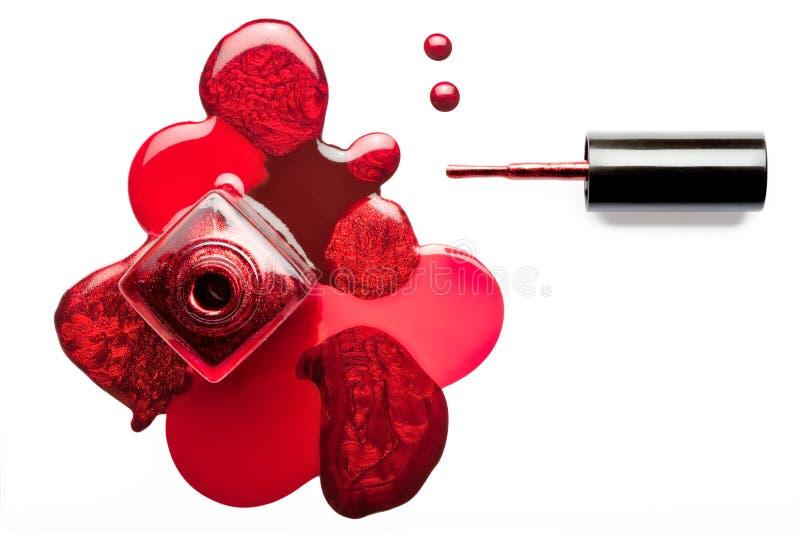 Fine art beauty concept of nail varnish. Red metallic nail polish stock photos