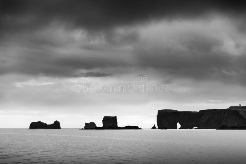 Reynisfjara Beach and Dyrholaey at Vik, Iceland. Fine Art, Black and White landscape of the Reynisfjara Beach and Dyrholaey stock image
