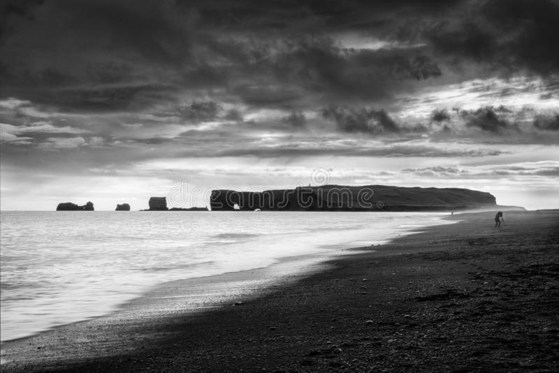 Reynisfjara Beach and Dyrholaey at Vik, Iceland. Fine Art, Black and White landscape of the Reynisfjara Beach and Dyrholaey royalty free stock photos