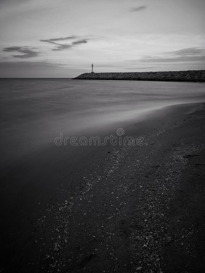 Fine art in black & white of lighthouse at Pantai Senok Beach, Kelantan stock photos