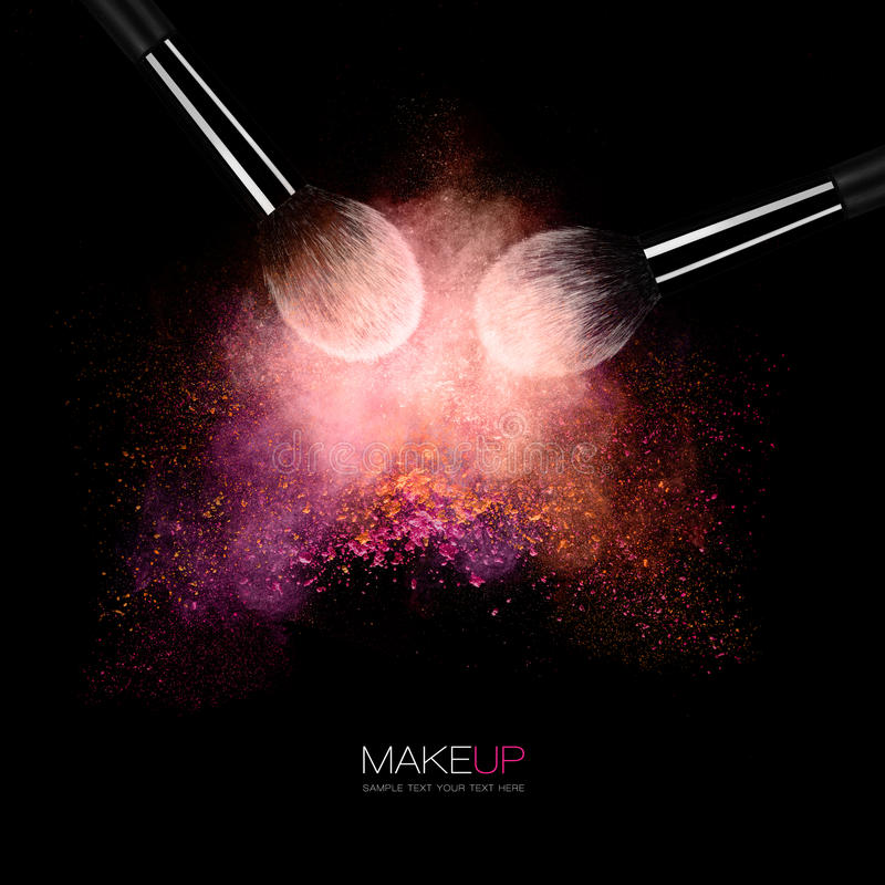 Fine art cosmetic, makeup and beauty concept. With two highlighted brushes and a puff of colorful powder or eye shadow on a black background with copy space stock photo