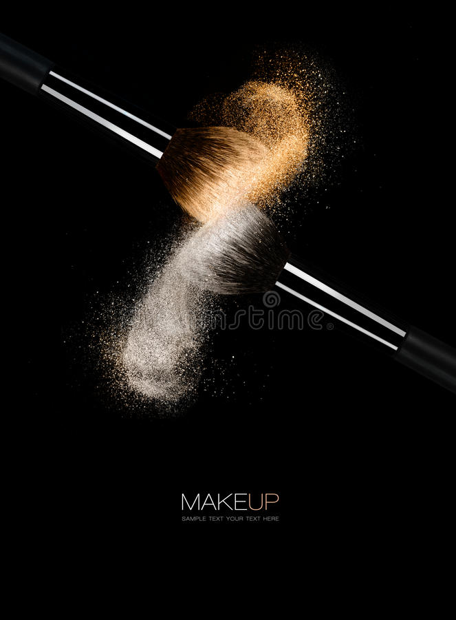 Fine art cosmetics concept with brushes. Fine art cosmetics and makeup concept with sprays of highlighted gold and silver pigment powder on soft bristle make-up stock image