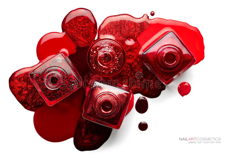 Fine art cosmetics image. Set of trendy red nail polish. Fine art cosmetics and beauty image. Nail art concept with a set of trendy red nail polish spilled stock images