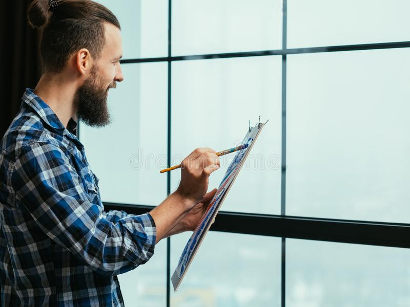 Fine art creative process inspired guy painting royalty free stock image