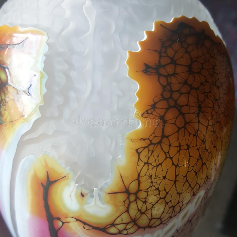 Fine art details. Details of a blown and sandcarved museum quality fine art creation by master American contemporary glass blower Noel Laue stock photo