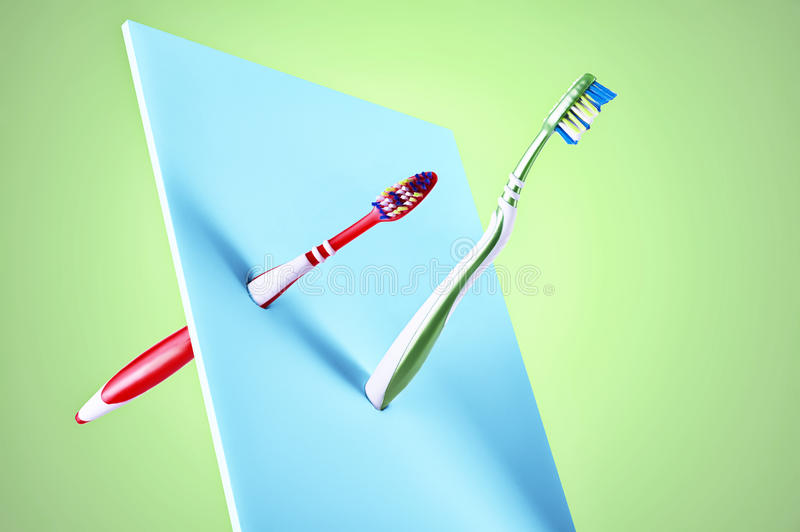 Fine art display of two new plastic toothbrushes stock photo